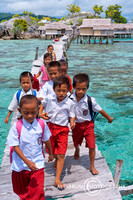 Elementary school students cross the bridge about two kilometer