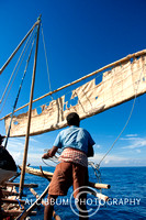 Lamalera people embark their traditional wooden sailing boat, hu