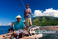 Lamalera people embark their traditional wooden sailing bo