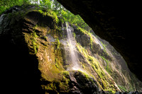 A beautiful waterfall drops to a ravine's floor.