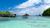 Traditional Fishing Hut in The Middle of The Sea With Beautiful Crystal Cleat Sea Water and Dramatic Sky, Togean Island, Indonesia