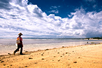 A Fisherman Walking in The Beach to Go to Fishing