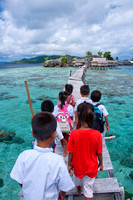 Elementary school students cross the bridge about one kilometer