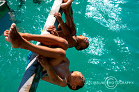 Bajo Children hanging on  A Wooden Beams During Swimming in The