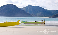 Wooden Fishing Boat on Beautiful White Sandy Beach, Selong Belan