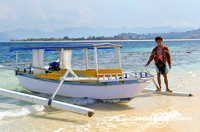 The Fisherman Stand Beside  Wooden Fishing Boat on Beautiful Bea