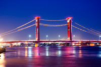 Glowing Ampera Bridge at dusk