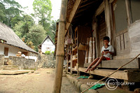Boy From Kampung Naga Sitting Infront of House